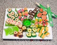 The sushi was all made with candy, rice treats we prepared, fruit roll ups and fruit by the foot. Candies included – runts, mini M's, Swedish fish, Rainbow colored Twizzlers, Various Little Debbie snack cakes, gummy worms/snakes, Candy Lime Slices & Marshmallows.
