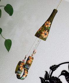 Wine bottle windchime, Amber wind chime, Orange and Yellow flowers, yard art, patio decor, recycled bottle wind chime, hand painted chime by LindasYardArt on Etsy