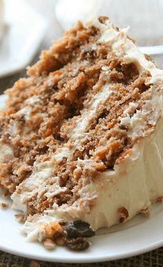 Southern Style Carrot Cake _ A Southern Tradition! Probably the best I've ever had. Adapted from a special cookbook created by a friend. Moist layers full of sweet carrots raisins. In between is cream cheese frosting oh so yummy chopped pecans! Köstliche Desserts, Delicious Desserts, Yummy Food, Southern Desserts, Food Cakes, Cupcake Cakes, Cupcakes, Cake Recipes, Dessert Recipes