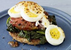 Egg Sandwich: Fill 1 whole wheat English muffin with 1 slice reduced-fat Swiss cheese, 1 slice tomato, 3 baby spinach leaves, and 1 egg fried in 1 tsp olive oil. Eat with 1 small apple.