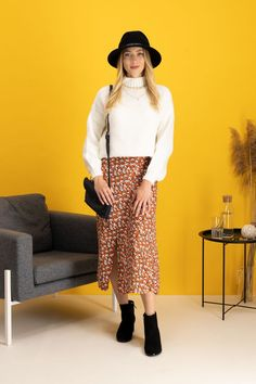 autumn | autumn outfit | spring outfit | summer outfit | autumn fashion | womensoutfit | casual outfit | women autumn outfit | womens florals skirt | womens patterned skirt | womens white sweater | womens black hat | womens black handbag | womens heeled ankle shoes | womens heeled ankle boots | womens black ankle boots | fashion inspo | outfit inspo #ootd #factcooloutfit