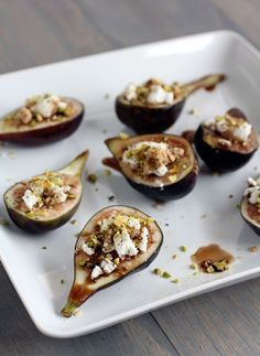 Fig, Goat Cheese & Pistachio Appetizer. Place fig halves on a serving platter and lightly press about 1 teaspoon of goat cheese into the center. Sprinkle chopped pistachios and pepper to taste in a small bowl, whisk together honey and balsamic vinegar and drizzle over figs.