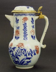 A Rare Chinese Export Porcelain Ewer, Kangxi period c.1690-1720. Decorated in Under-Glaze Colours ; Cobalt Blue, Copper Red, and Celadon Green (Iron-Oxide). The Mounts Probably 18th Century. It is very unusual to find this colour combination on a Kangxi porcelain (1662-1722) ewer. Provenance : From an American collection.