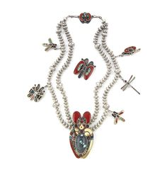 """""""Butterfly Songs"""" Necklace - A Phil Lorreto Masterpiece. This necklace has the finest inlay work of fossil ivory, Mediterranean coral, turquoise, jet, abalone, mother-of-pearl, and Royal Web turquoise.  Circa late 1970′s.  This necklace was featured in the exhibit Totems to Turquoise and is featured in the book."""