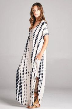 Sit back and relax in this jersey knit maxi dress with sleeves. Features a Very flowy fit perfect for longroad trips or days when you need a simple yet chic wa