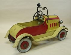 c. Mid 1930's, this may be the best one ever found, an all original pedal car, done in bright yellow and red body, nickeled headlamps, lamp on windshield, decal bills the ''ball bearing gear,'' full fenders and running boards, ''Hudson'' grille plate, hood tin with ornament.  45'' long. Missing one hub cap, crazing to paint, (Exc. Cond.)