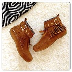 ⭐️SIZES 5 or 5.5⭐️NIB Studded Fringe Booties Tan NIB Studded Moccasin Booties. The best moccasins for any boho look! Draped fringe with woven ankle detailing. Gold studded adjustable ankle straps. Inner ankle zippers for easy on and off wear. Rounded toe, textured sole, man made materials. FITS TRUE TO SIZE. Available in sizes 5, 5.5🚫No Trades and No Paypal🚫Will not be restocked! Shoes Ankle Boots & Booties