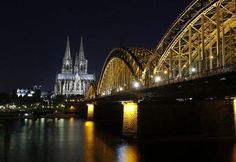 UNESCO World Heritage Cologne Cathedral and the Hohenzollern railway bridge along the river Rhine are seen before Earth Hour | View photo - Yahoo News Philippines