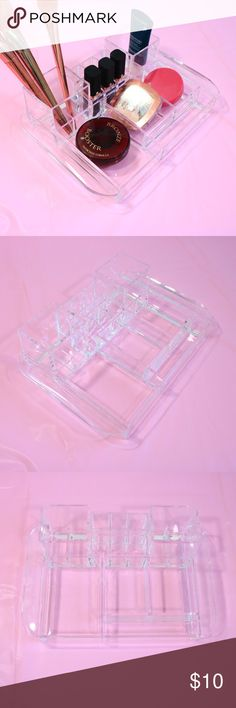 Clear Acrylic makeup organizer holder Great to store makeup and beauty essentials! Has multiple compartments . It holds 6 lipsticks and the rest of the compartments can be used to display brushes and powders. Size: 10 1/2 X 7 inches. **Makeup not included. Makeup Brushes & Tools