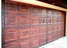 Doortec Garage Doors beautiful gel stained to like wood. Installed on #Wednesday right before #BackToSchool. Make your house have more curb appeal with this awesome #garagedoor