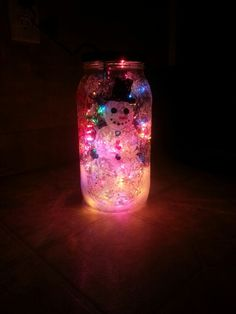 So proud of our new holiday decoration!! With the lovely help of my step son! Simply painted the jar, cut a hole in the top with a drill press, and put the string of lights in!! It also has a Christmas tree on one side with our finger prints as the ornaments and says merry Christmas!!!!