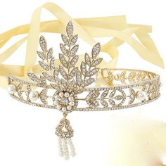 Fabulous Great Gatsby Daisy Buchanan headband has a wonderful vintage style.  This is my version of the headpiece worn by Daisy Buchanan in The Great Gatsby.  NOT the cheap knock offs made in China.  I added more glam by incorporating many more Swarovski rhinestones and pearls. Ribbon comes in your color choice.  Can be finished in silver or gold.   please find the matrching pieces in my Great Gatsby Section in my shop.