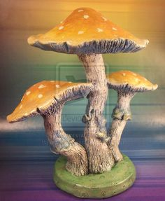 The mushrooms and their base are created with ProSculpt Polymer Clay over a wire armature. Painted with quality acrylics.