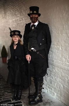 """`.""""Megan Waller, aged nine, and her father Heath Waller at the Whitby Goth Weekend."""" ...Quite frankly, I would love to dress as both of these folks."""