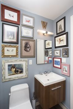 This bathroom serves as a gallery. It makes a great conversation starter!