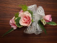 Pretty in pink corsage & boutonniere of baby pink roses, variegated leaves, custom sheer ribbon and finishing touches.  www.urbanelementsinteriorspace.com Portland, OR