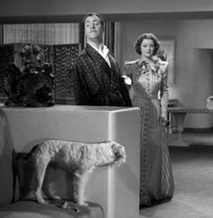 William Powell, Myrna Loy, and Skippy (aka Asta) in After the Thin Man (1936). Asta picks the darndest times to play hide-and-seek! Gimme that clue!