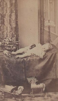 CDV from England, with all his favorite toys, holding one shoe, which was symbolic of something, but I forget what.