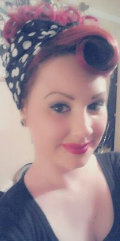 Victory roll hairdo updo vintage inspired hair with polka dot scarf