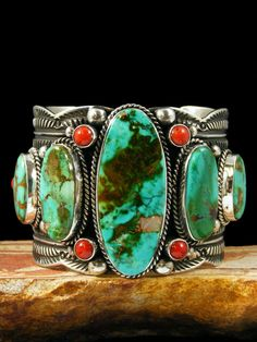 Navajo stamped silver, turquoise and coral cuff.