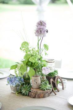 Centrepiece - wood slab, jars, purple flowers, twine, rustic, horseshoe, succulents