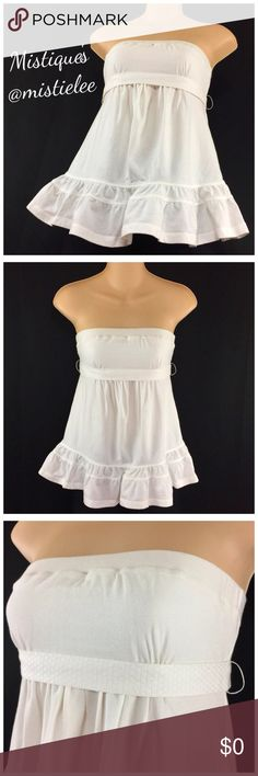 """Vs Gorgeous Snow White Versatile Tube Top S Made by: Moda International Size Small Purchased through Victoria's Secret online. White Cotton Tube Top w/Ruffled Hem and removable Textured Sash. Can be worn with or without. Measurements: Flat across Elastic Top 13.5""""+Stretch Empire Waist 12.5""""+Stretch Top to Hem 18"""". PreLoved: Excellent condition. Thank you for browsing my closet. Moda International Tops"""