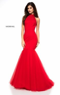 Mermaid prom dress with halter top and tulle skirt. Available in red, black, and light blue.