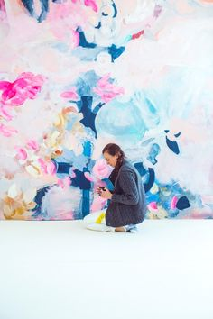 Tracey, JCrews set director, creating one of a 3 part 10x10foot abstract painting of the flowers on set for a backdrop in a recent set // Behind the Scenes: In Full Bloom – J.Crew Blog