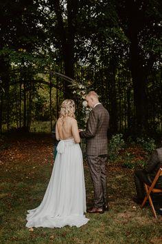Bride wears an elegant backless dress for a rustic woodland wedding. Images by Camilla Andrea Photography #backlessweddingdress  #weddingdress #weddinggown #bridalgown #bridaldesigner #weddingfashion #weddingstyle