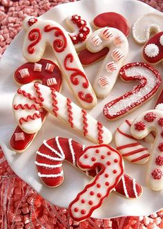 Fabulously festive Candy Cane Sugar Cookies. #candy #cane #red #white #cookies #food #baking #dessert #sugar #Christmas #holidays #decorated