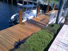 DEFY Extreme Wood Stain in natural pine on a white pine dock