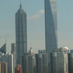 World's Tallest Skyscrapers: The Shanghai World Financial Centre is a soaring glass skyscraper with a distinctive opening at the top.