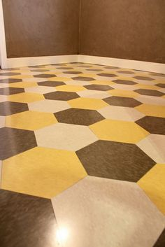I really like this flooring for a laundry room! Inexpensive vinyl composite tile cut into hexagons.