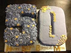 Number 50 birthday cake. Purple and gold. Buttercream rose swirls and icing covered cakes.  MTO.