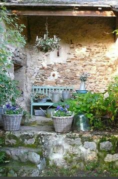 Charming French farmhouse outdoor sitting area with rustic stone, chandelier, and green bench, French Farmhouse Decor Inspiration Ideas will take you on a romantic tour of images capturing this charming decor style.
