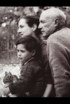 Beautiful family portrait of Pablo Picasso & his family with their beloved cat.