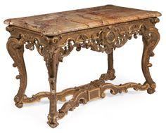 CONSOLE «toutes faces» en bois sculpté et doré, à décor de coquilles et rinceaux feuillagés. Entretoise en X. XVIIIe siècle. Dessus de marbre rouge mouluré. H_81 cm L_130 cm P_68 cm