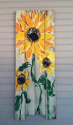Sunflower wall panel made from old fence boards! Love this!!