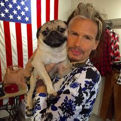 Doug the Pug getting some lovin' from Steven Tyler ----- P.S. click on the image to check out our Funny Pugs T-shirt today! All sizes available in different colors.