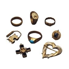 Jewellery from the Fishpool hoard from mid-15th century ADin  found Nottinghamshire, England. The hoard was found in 1966 and comprises comprises 1,237 coins, four rings, four pieces of jewellery and two lengths of chain. One ring, of plain gold, carries an English inscription inside the hoop which means 'Lift up your whole heart'.