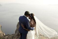 Photo shooting, couple, bride, groom, wedding dress, greek colors, blue, wedding, weddingplanners, Santorini, caldera, cliff,  thediamondrock, weddingdestination, happyday, specialday, happening, love