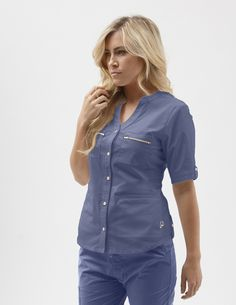 Sophisticated yet dainty button down design with signature gold logo buttons, double chest zip pockets and front welt pockets for storage. A professional, tailored look that truly redefines the medical apparel category.