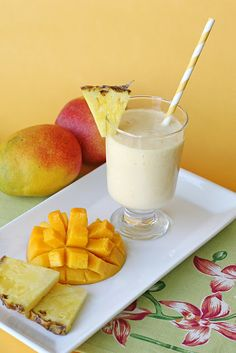 Aloha Smoothie ~  (serves 2)    1 fresh mango, peeled and chopped (or 1 cup frozen chunks)1 cup fresh or frozen pineapple 1/2 of a banana, fresh or frozen (nice and ripe) 1/2 cup lowfat vanilla yogurt  1 cup milk A handful of ice    Blend all of the ingredients in a blender until smooth.  Pour into glasses and enjoy!  Sounds good.