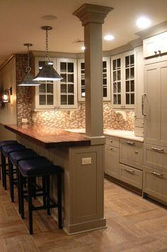 like the wood bar top and colour of cabinets and also floor - is that hardwood or tile? More