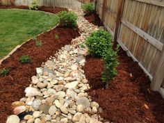 Dry Riverbed with perennials, trees, and shrubs. Installed by Glacier View Landscape and Design, Inc. Erie, CO