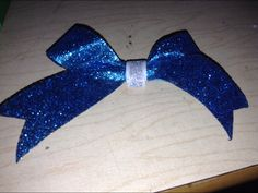 This bow is blue and silver glitter! This is a part of Ruthi's new mini bow product line!