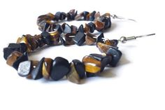 Check out this item in my Etsy shop https://www.etsy.com/listing/241987969/tigers-eye-and-black-jasper-large-hoop