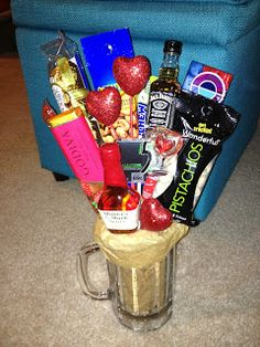 Man-bouquet. Valentine's Day gift idea for guys. *** I think this would be fun for ladies too.  I'd totally love a bouquet that includes candy and treats along with a flower or two.
