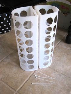 ideas for ikea plastic bag holder- hold wrapping paper rolls