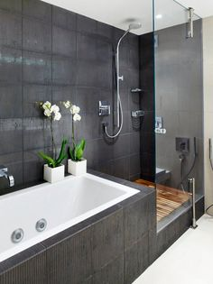 Having the bath and shower side by side is perfect for a long narrow bathroom. love the colour scheme and orchids!